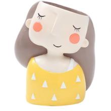 עציץ פרצוף- ילדה בחולצה צהובה